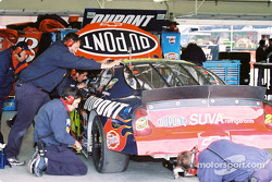 Crew works on Jeff Gordon's car