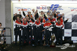 Race winners Frank Biela, Marco Werner and Phillip Peter celebrate with Infineon Team Joest