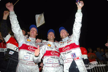 Race winners Frank Biela, Marco Werner and Phillip Peter celebrate
