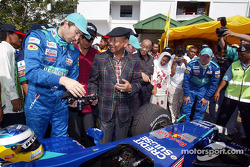 Pitstop demonstration in Alor Setar: Heinz-Harald Frentzen shows his car to his Majesty Tuanku AlHaj Abdul Halim Mu'adwam Shah, the Sultan of Kedah and Minister of Youth and Sports, Dato' Hishammudin Tun Hussein
