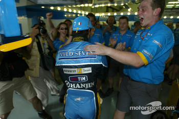 Renault F1 team members and Jarno Trulli celebrate first row