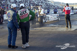 Gary Densham and John Force watch Ashley Force do a burn-out