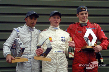 The podium: race winner Mike Conway with Lewis Hamilton and James Rossiter
