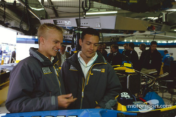 Heikki Kovalainen and Fabio Carbone visit Renault F1 garage area