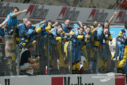 Renault F1 team members celebrate second place finish of Fernando Alonso
