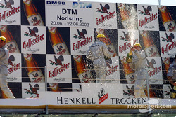 The podium: champagne for race winner Christijan Albers, Marcel Fassler and Bernd Schneider
