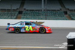Juan Pablo Montoya, in car, takes pointers from Jeff Gordon
