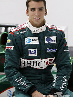 Justin Wilson poses with the Jaguar F1 car after his transfer to Jaguar Racing from Minardi at the Jaguar Racing factory in Milton Keynes