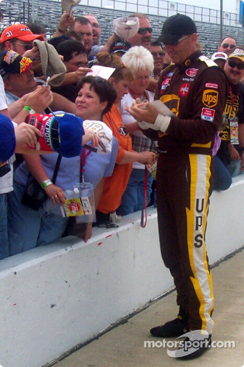 Dale Jarrett signs autographs