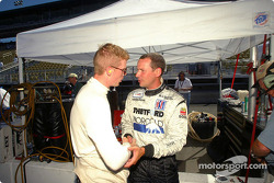 Butch Leitzinger is congratulated by a Dyson Racing crew member after winning the pole for Sunday's American Le Mans Series Infineon Grand Prix of Sonoma
