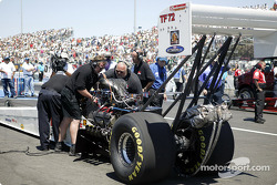 The crew works to start Mike Strasburg's dragster