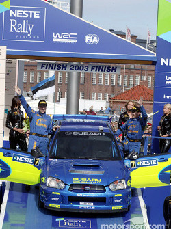 The podium: Petter Solberg and Phil Mills celebrate second place finish