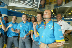 Renault F1 team members watch Fernando Alonso's qualifying lap