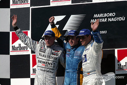 Podium: race winner Fernando Alonso with Kimi Raikkonen and Juan Pablo Montoya