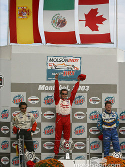 Podium: race winner Michel Jourdain Jr. with Oriol Servia and Patrick Carpentier