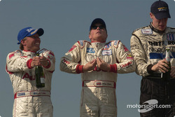 Podium: champagne for J.J. Lehto, Johnny Herbert and Chris Dyson