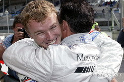 Pole winner Marcel Fassler celebrates with teammate Jean Alesi