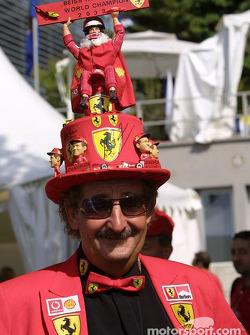 A fan proudly wears his Michael Schumacher 2003 World Champion hat