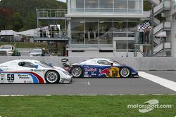 #58 Brumos Racing Porsche Fabcar: David Donohue, Mike Borkowski, Sascha Maassen takes the checkered flag in front of #59 Brumos Racing Porsche Fabcar: Hurley Haywood, J.C. France, Max Papis