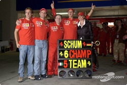 Michael Schumacher and Rubens Barrichello celebrate with Luca Badoer, Jean Todt and Corinna Schumacher