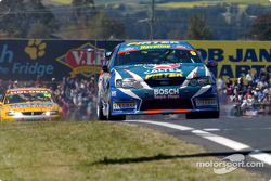 Mark Winterbottom leads Jason Bright along pit straight