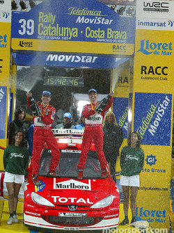 Podium: winners Gilles and Hervé Panizzi celebrate