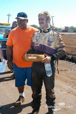 Hawaii Motor Speedway owner Jerry Apana awards Rick Ziehl another koa wood bowl trophy for second