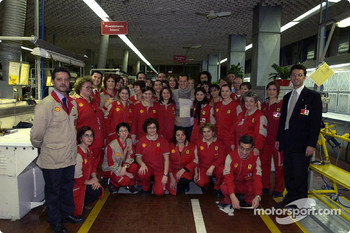 Michael Schumacher and Ferrari team members