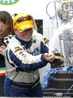 Podium: champagne for Marcos Ambrose
