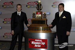 Matt Kenseth and Robbie Reiser pose with the Winston Cup Series Trophy