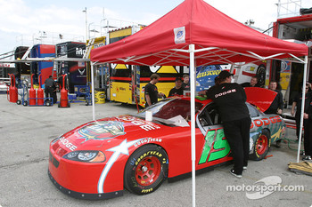 Evernham Motorsports crew members prepare the car