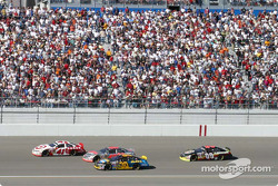 Casey Mears, Sterling Marlin and Johnny Sauter go three wide