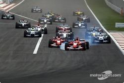 Start: Michael Schumacher leads Rubens Barrichello and the rest of the field