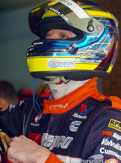 Garth Tander checks the results after the morning warm-up