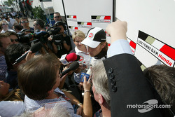 Scrum for pole winner Jenson Button