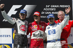 Podium: race winner Michael Schumacher with Jenson Button, Juan Pablo Montoya and Rory Byrne