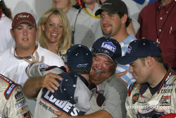 Race winner Jimmie Johnson celebrates victory with his crew