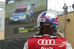 Mattias Ekström watches Christijan Albers on the giant screen