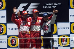 Podium: race winner Michael Schumacher with Rubens Barrichello and Takuma Sato