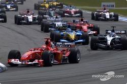 First corner: Michael Schumacher leads the field