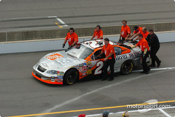 Tony Stewart crew push the car back to the garage