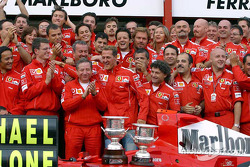 Michael Schumacher celebrates 7th World Drivers Championship with Ferrari team members