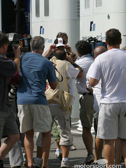 Jenson Button surrounded by photographers