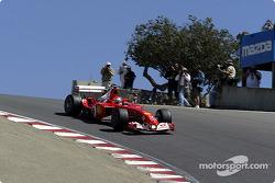 Ferrari test driver Andrea Bertolini slips down the corkscrew