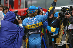 Pole winner Jarno Trulli celebrates