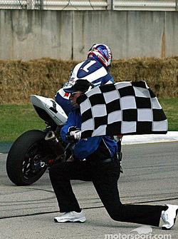 Mat Mladin takes the checkered flag