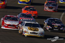 Dale Jarrett leads a group of cars