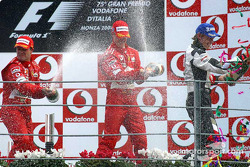 Podium: champagne for Rubens Barrichello, Michael Schumacher and Jenson Button
