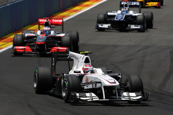 Kamui Kobayashi, BMW Sauber F1 Team leads Jenson Button, McLaren Mercedes