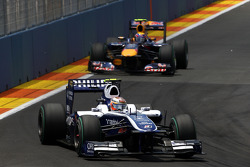 Nico Rosberg, Mercedes GP leads Mark Webber, Red Bull Racing